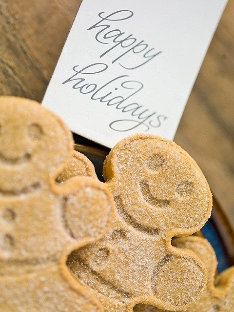 gingerbread candies and happy holidays tag